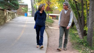 Mary C. Saunders and Robert Stikmanz stroll the creek trail in Boulder, CO, 10/21/011